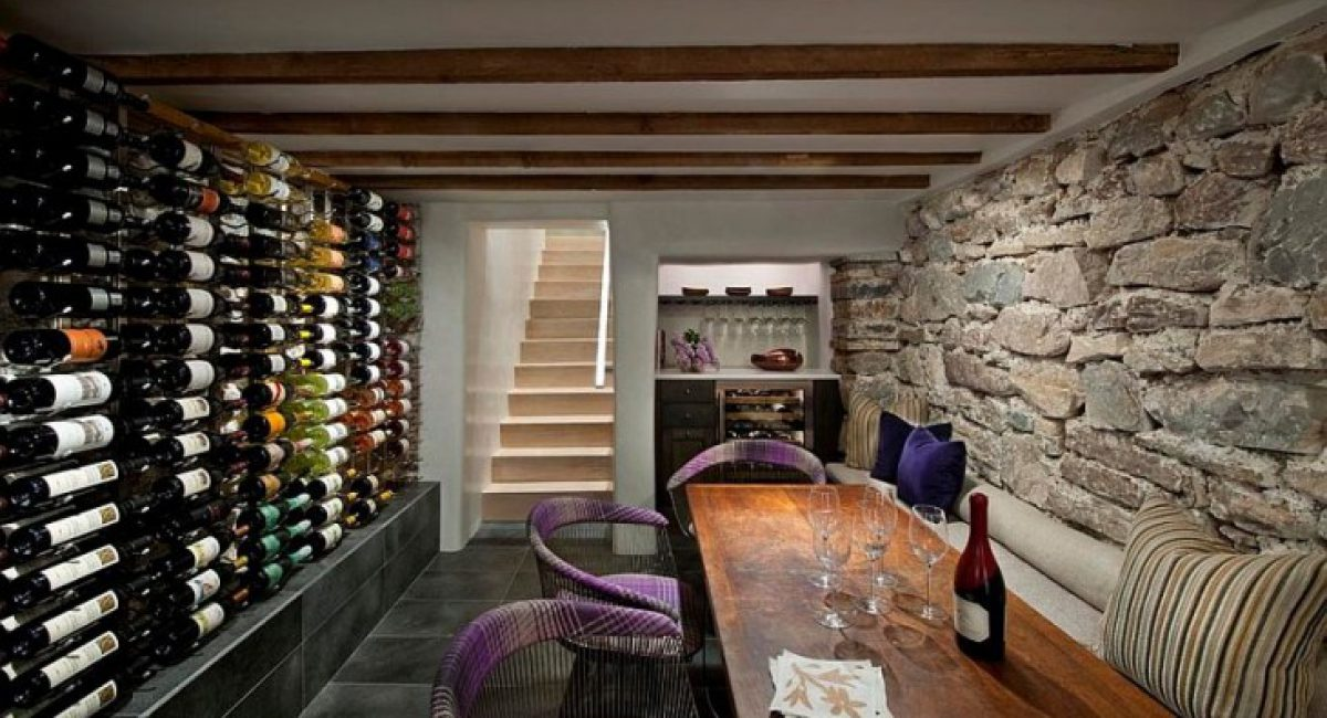 Chairs-add-color-and-informal-charm-to-the-wine-tasting-room-with-stone-walls-decoist-e1506919861633