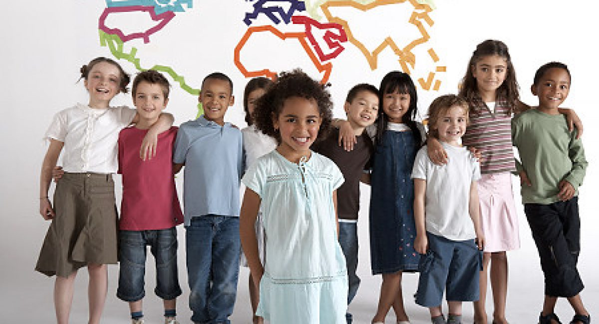 Group of children (4-11) standing in front of outline map of earth, smiling, portrait   Original Filename: sb10066340g-004.jpg